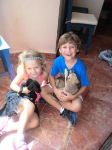 My friend Tiffany's children Lior and Barlow with pups at Isla Animals