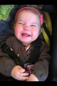 Happy smiling baby in stroller