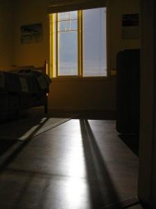 moonlight shining through a bedroom window