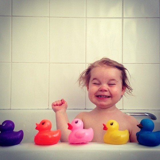 Baby, bathtub, rubberduckies, bath time, smile, silly, happy